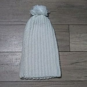 Stocking cap white with a Puff on top.